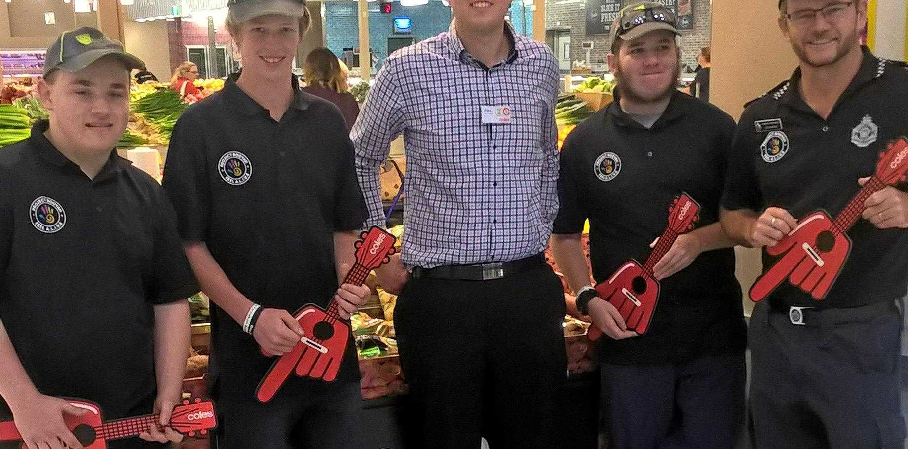 MAKING A DIFFERENCE: Their prices may be down but the community support is up. (from left) Liam, Blayze, Alex (Coles manager, Stockland) Tery and Joe.