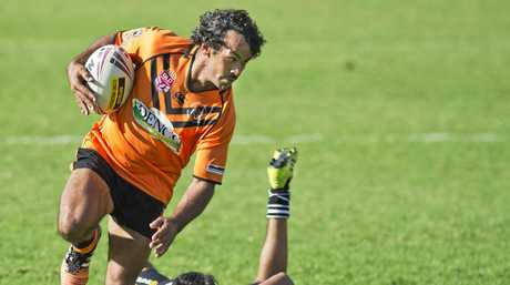 ELUSIVE: Souths fullback Corey Blades runs away to scores a try against Oakey.
