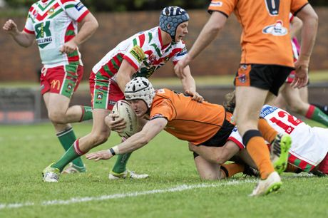 LEADING THE WAY: Souths captain-coach Daniel Holmes tests out the Pittsworth defence.