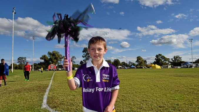BATON CARRY: Hayden Thorton-Barrett at the 2016 Roma Relay for Life event at Cities Oval.