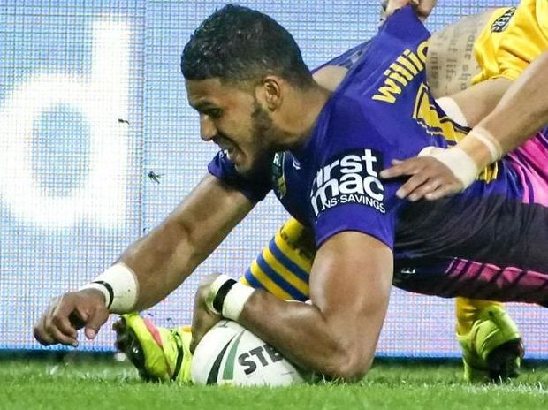 Jonus Pearson of the Broncos scores a try against the Eels in round 23.