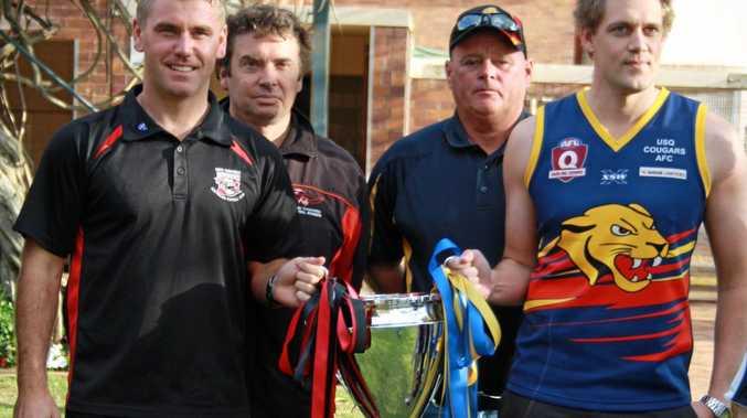 BIG PRIZE: South Toowoomba captain Dan Lyon, coach Shaun Reardon, University coach Tony Bullen and captain Cory Balnaves ahead of the AFL Darling Downs grand final.