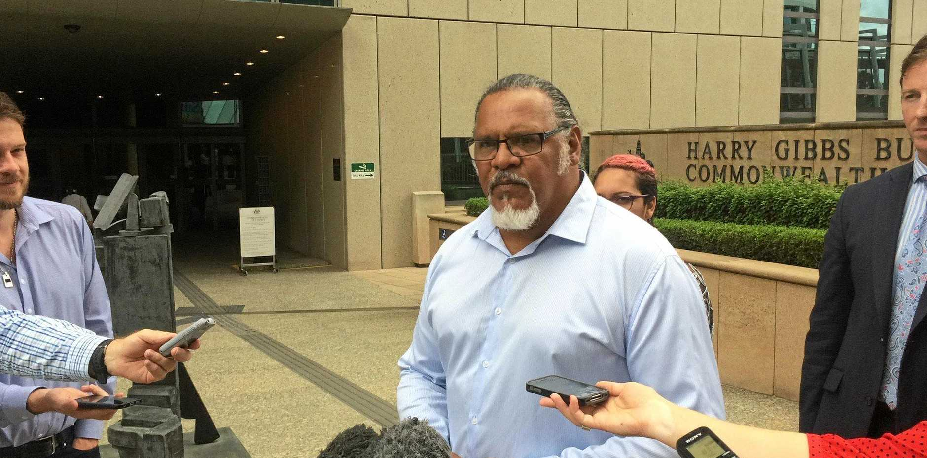 Adrian Burragubba, spokesperson for the Wangan and Jagalingou traditional owners's council outside the Brisbane Federal Court Monday. Photo: Geoff Egan / APN NEWSDESK