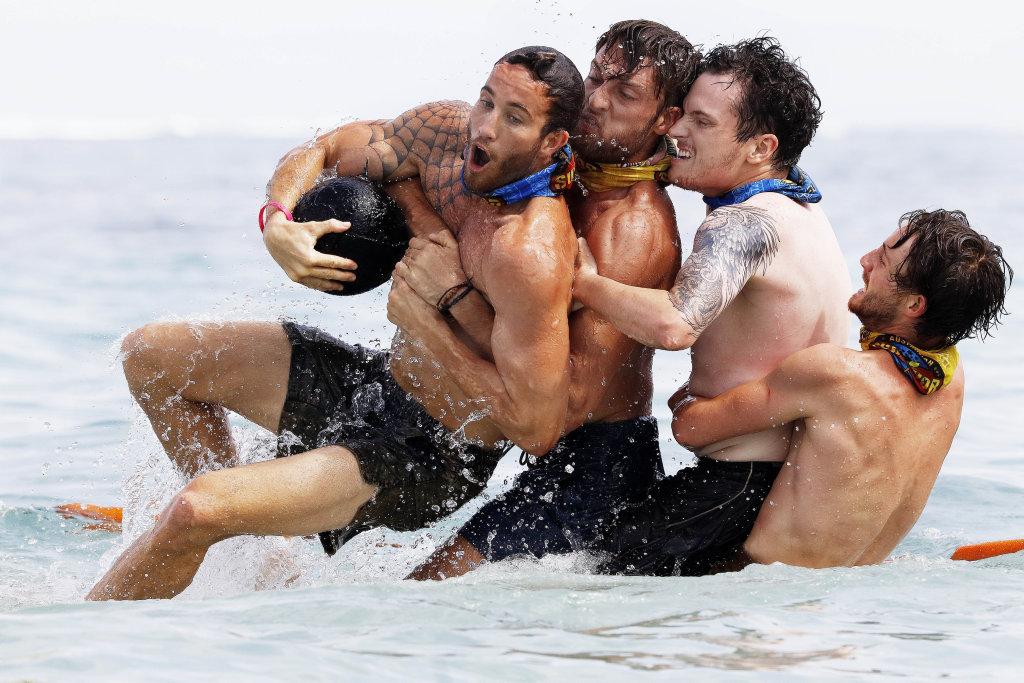 Sam Webb, Rohan MacLaren, Matt Tarrant and Conner Bethune compete in a challenge in a scene from Australian Survivor.