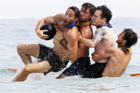 Sam Webb, Rohan MacLaren, Matt Tarrant and Conner Bethune compete in a challenge in a scene from Australian Survivor.
