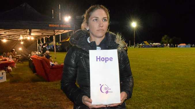 CANCER SURVIVOR: Shel Rowbotham holds hope in her hands for her family at the 2016 Roma Relay For Life event at Cities Oval.