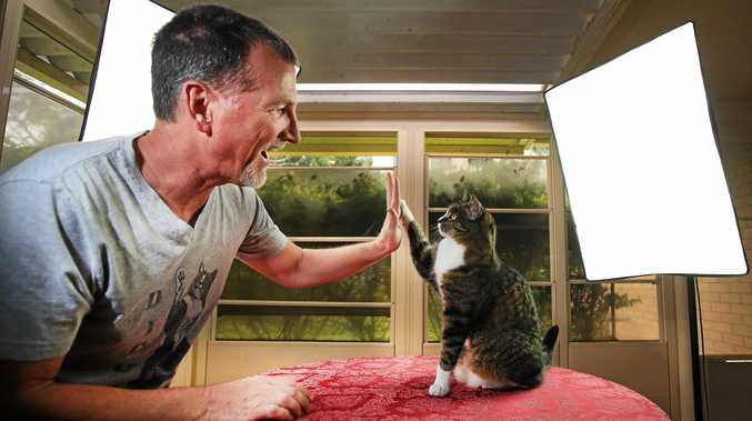 Robert Dollwet with his wonder cat Didga who has just broken a Guiness World Book of Records record.