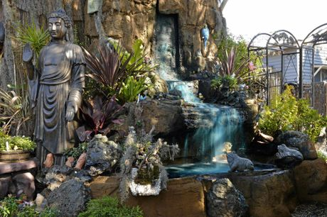 Water features, ornaments and large statues can bring to life a small area in the backyard.