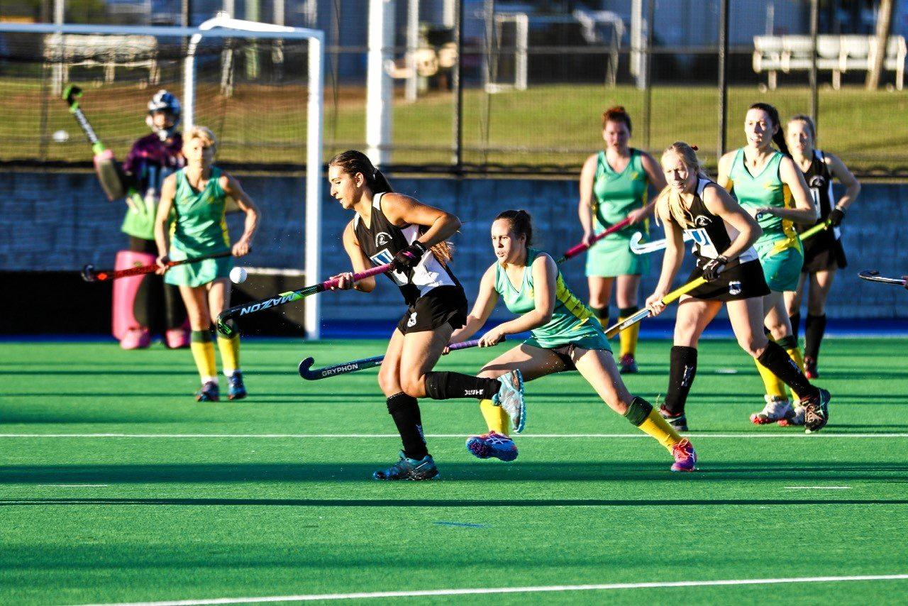 Wests players Lauren Hess (left) and Eden Jackat (behind) should play key roles in Saturday's Ipswich A-Grade hockey grand final.