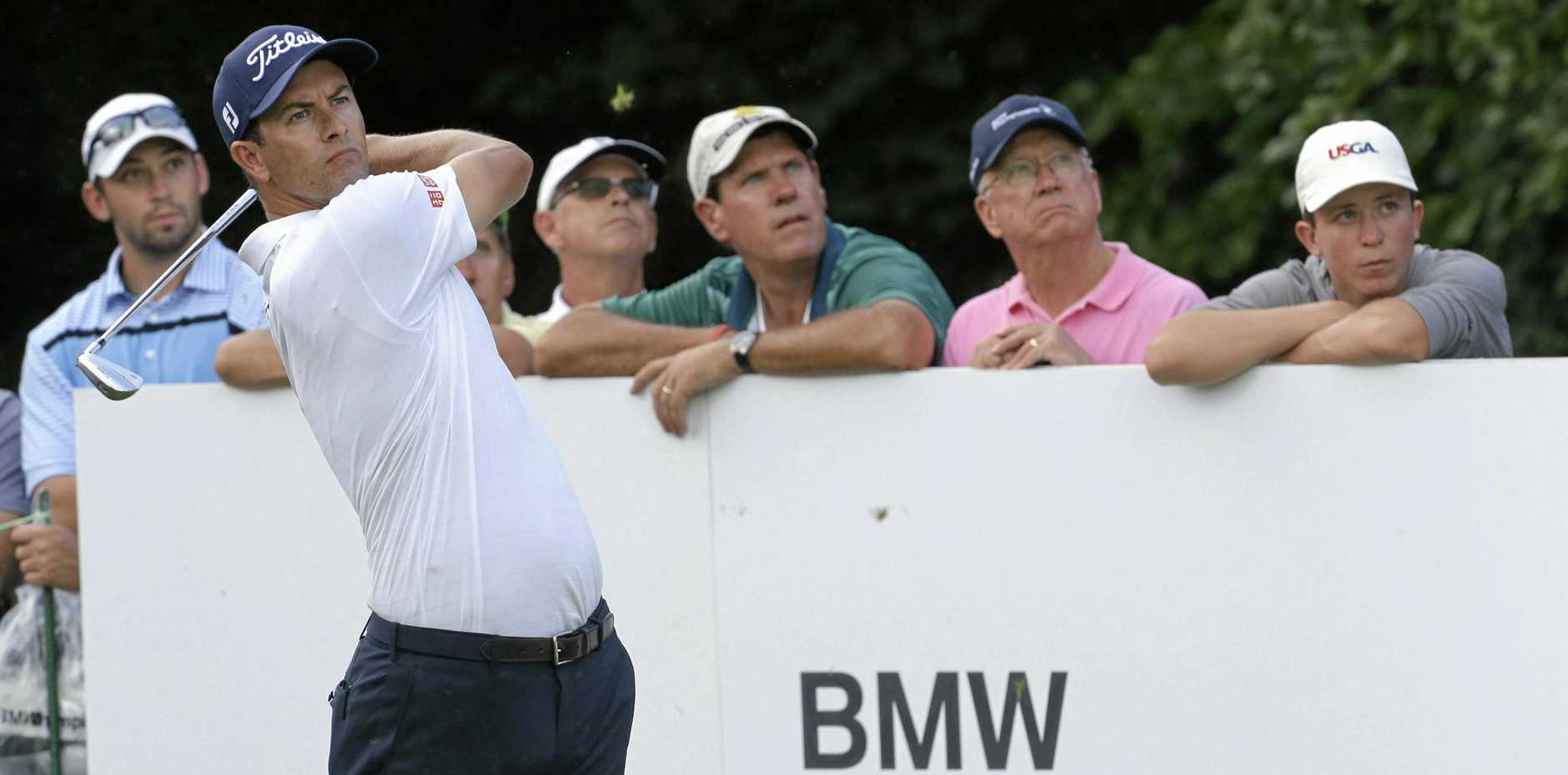 Adam Scott, of Australia, watches his shot from the sixth tee during the first round of the BMW Championship.