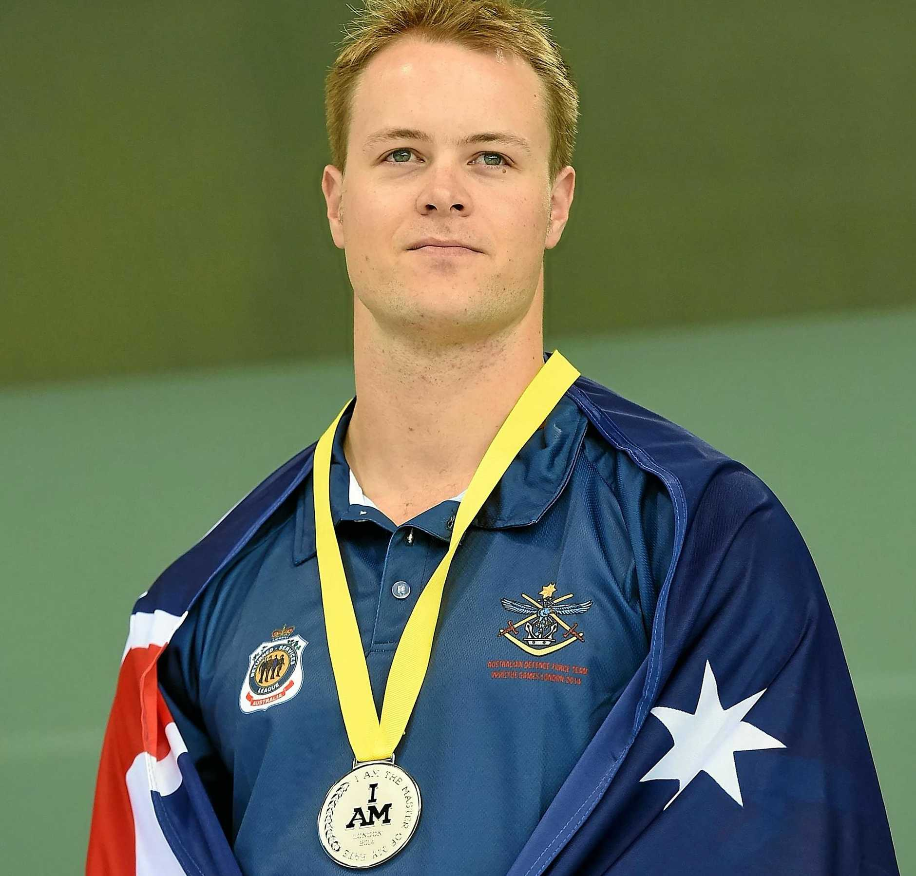 Curtis McGrath won a silver medal for swimming at the 2014 Invictus Games for injured servicemen and women.