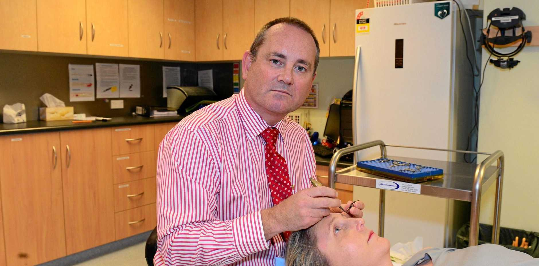 Dr David Kitchen (with a client) when he worked at CQ Eye.