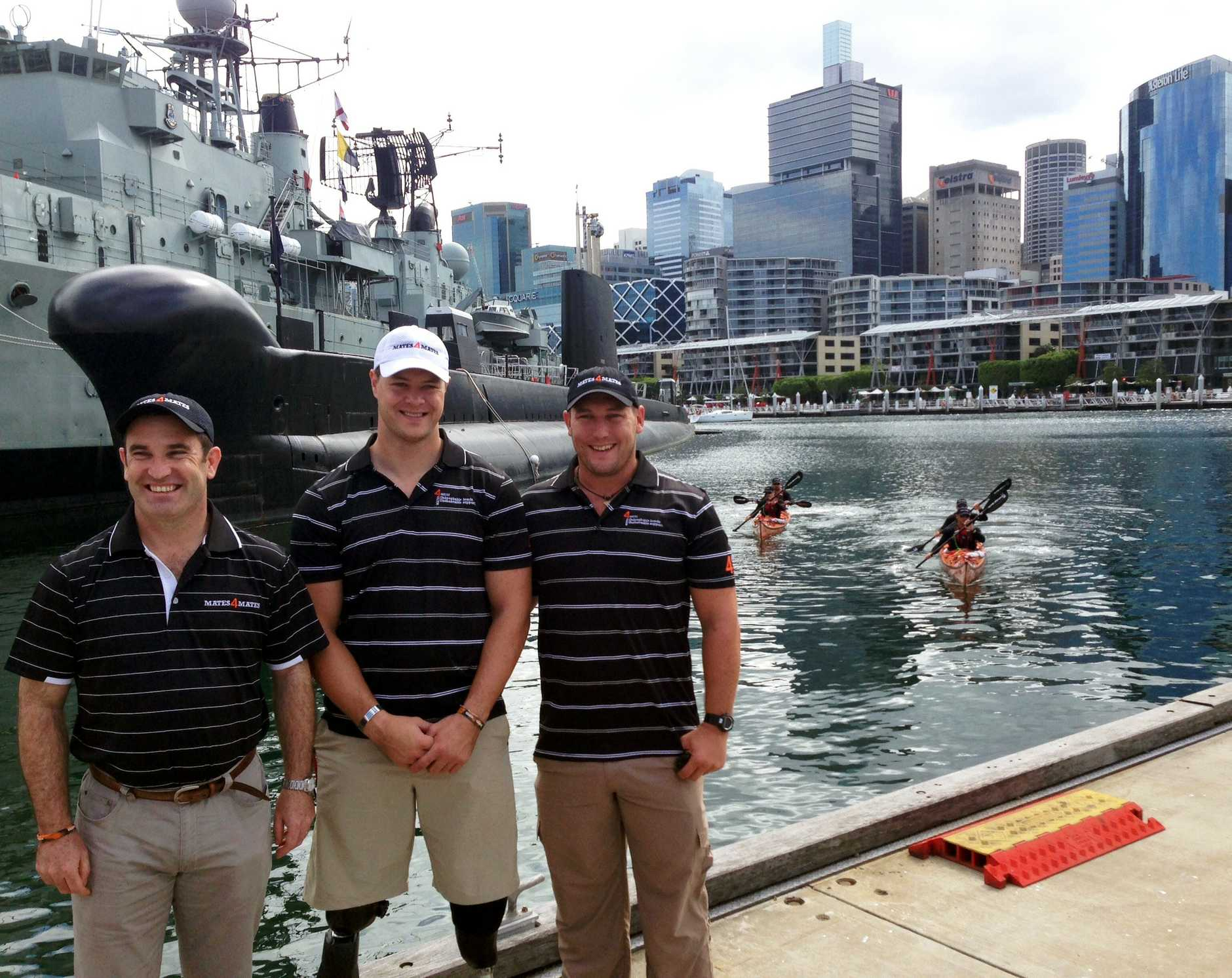 Mates4Mates COO Michael Quinn, Sapper Curtis McGrath and Corporal Tyson Murray posing for a photo at Darling Harbour in Sydney in 2013. McGrath was among 23 current and former Australian Defence Force personnel who clocked up to 1000 gruelling kilometres in the Mates4Mates sea kayak challenge.