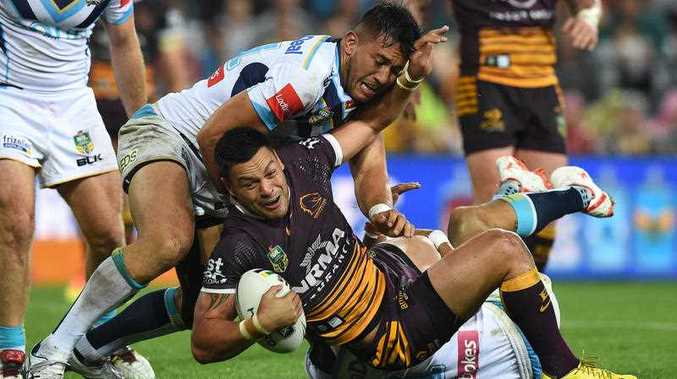 Broncos player Alex Glenn eyes up the tryline during the NRL Elimination Final between the Brisbane Broncos and Gold Coast Titans at Suncorp Stadium in Brisbane, Friday, Sept. 9, 2016.