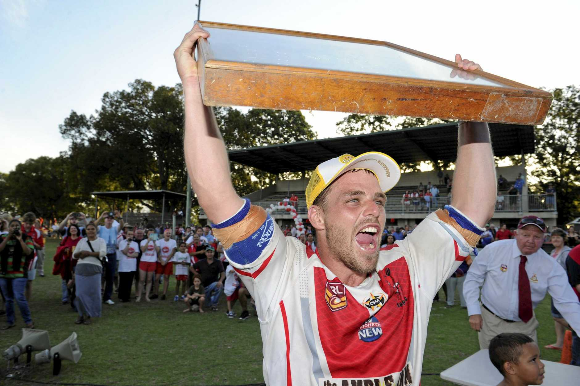 Rebel captain Rhys Walters holds up the trophy after winning the Group 2 Country Rugby League 1st Grade grand final between South Grafton Rebels and Coffs Comets at McKittrick Park South Grafton on Sunday 23 August, 2015. Final score Rebels way 46-18. Photo Debrah Novak / The Daily Examiner