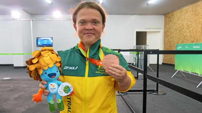 BRONZED AUSSIE: Withcott athlete Claire Keefer shows off her bronze medal won in the F41 shot put at the Rio Paralympic Games.