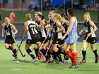 Wests teammates embrace player of the final Erin Mackay after she scored her team's first goal in the Ipswich A-Grade hockey grand final on Saturday night.