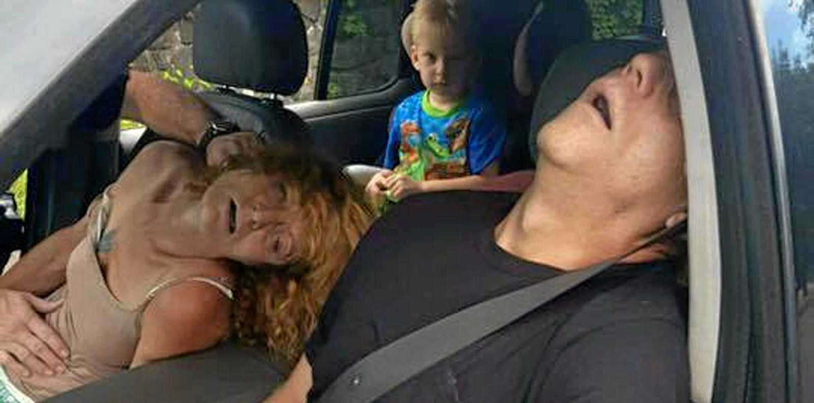 EFFECTS OF HEROIN: A police officer pulled over this driver for driving erratically. The woman had passed out from an overdoes and the driver became unconscious too. A passer-by snapped this photo.