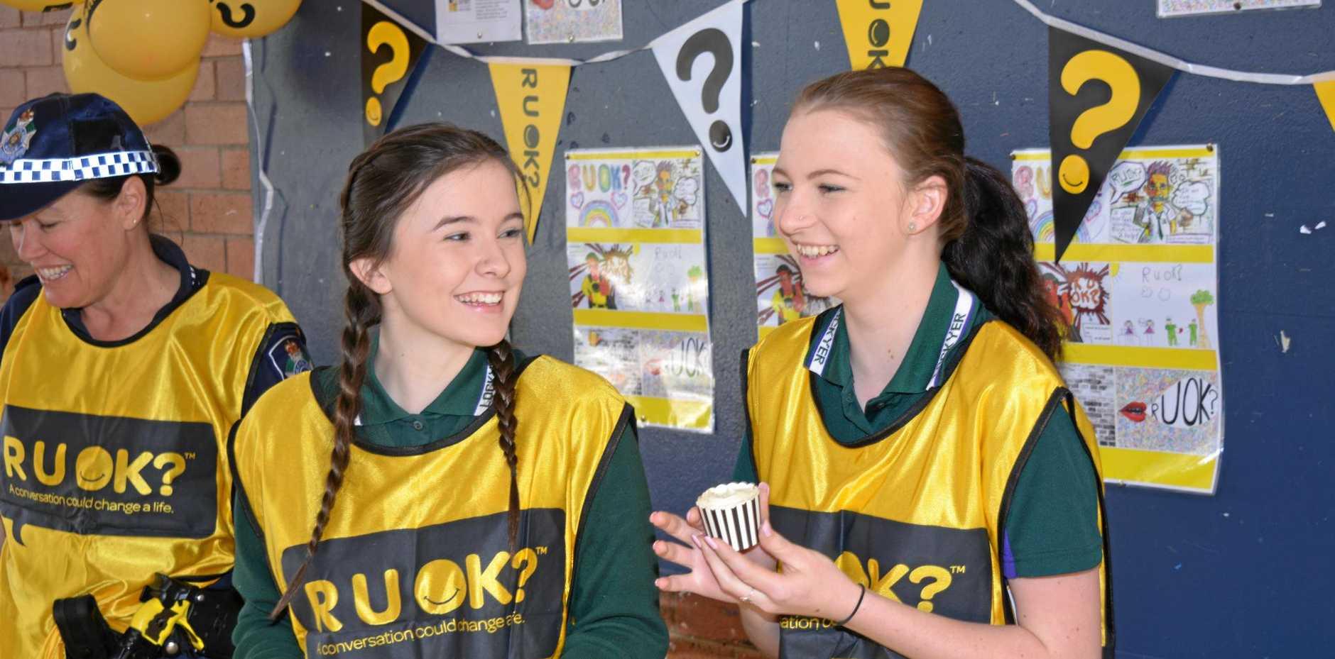 A-OK: Alysha Hickmott and Emma Ditchmen at the R U OK? Day stall.