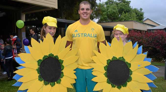 SUNNY DISPOSITIONS: Olympian Matthew Denny with the Sunnygirls, Logan Lucas and Xanthe Esson.