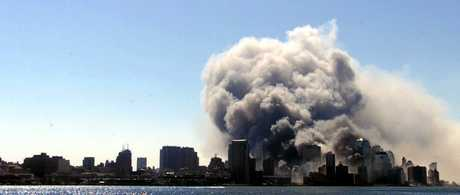 Smoke billows from downtown Manhattan after The World Trade Center collapses in New York, Tueseday, Sept. 11, 2001, in this photo taken from a vantage point in Hoboken, N.J.  In unprecedented show of terrorist horror, the 110-story World Trade Center towers collapsed in a shower of rubble and dust Tuesday morning after two hijacked airliners carrying scores of passengers slammed into the sides of the twin symbols of American capitalism. (AP Photo/The Daily Record, Mike Buscher)
