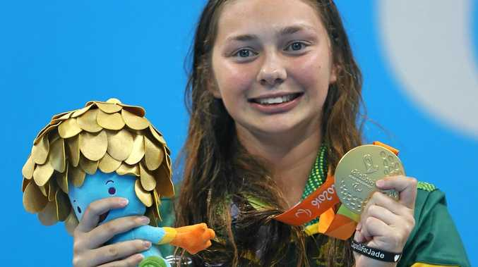 Gold medalist Maddison Elliott of Australia poses for photographs on the podium at the medal ceremony for women's 100m freestyle S8 in Rio.