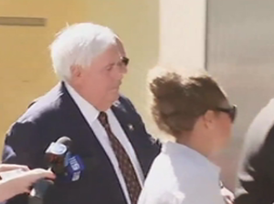 Palmer and entourage clash with media outside court