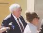 Clive Palmer scuffles with reporters