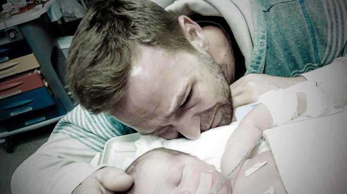 GRIEVING: Jason Clifford with his son Phoenix Rain Clifford.