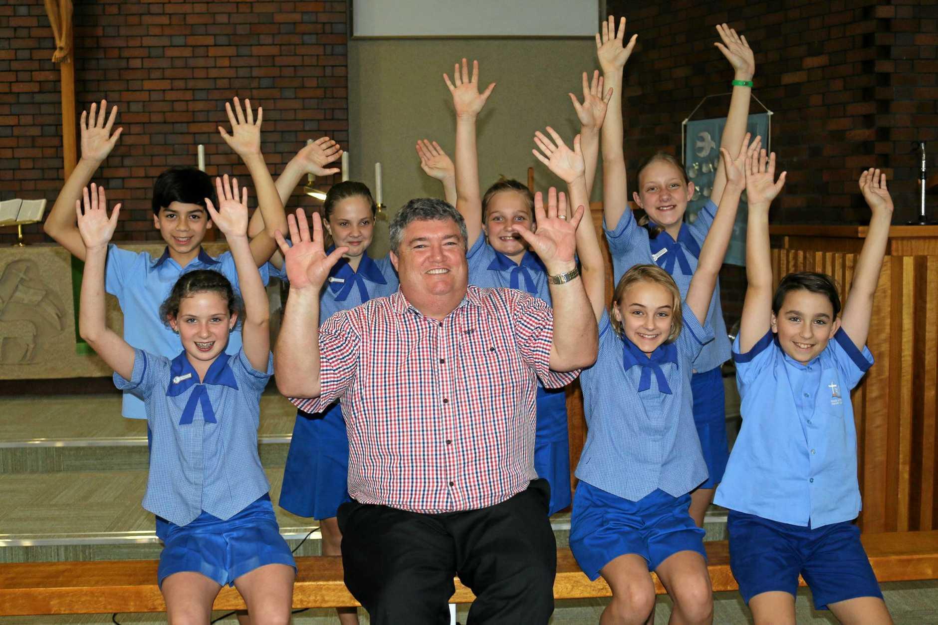 BIG EFFORT: Buy a Bale CEO Charles Alder celebrates Peace Lutheran Primary School's donation.
