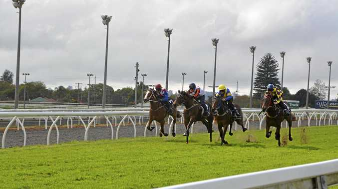 Lope de Lady (outside) and apprentice Bec Williams on their way to victory in heat three of today's Clifford Park two-year-old barrier trials.