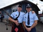 Retiring police officer Sergeant Bruce Maclean (right) is embraced on his last day of work by his younger brother Sergeant Neil Maclean.