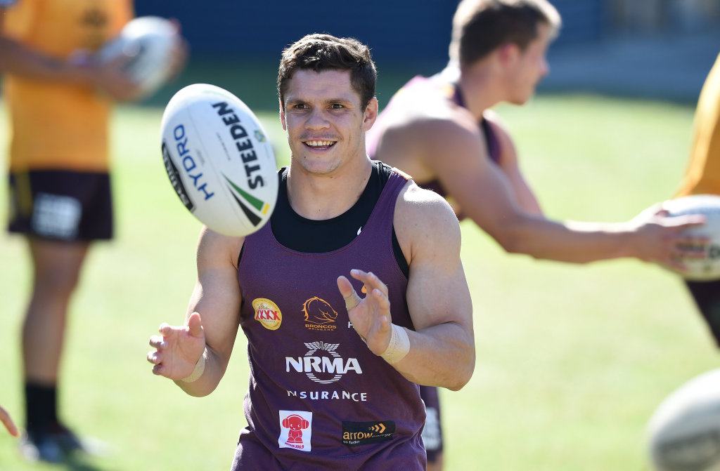 James Roberts receives the ball during the Brisbane Broncos training session in Brisbane, Monday, Sept. 12, 2016. The Broncos play the North Queensland Cowboys in an NRL semi-final in Townsville on Friday. (AAP Image/Dave Hunt) NO ARCHIVING