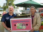 Each year the Yeppoon Surf Lifesaving Club holds their Charity Golf Day and the Yeppoon Community Market donates the tomatoes, lettuce, onions and carrots for their b-b-que.  Pictured Bill Cumming from the Surf Lifesaving Club and Gerry Kleinmeulman from the Community Market.
