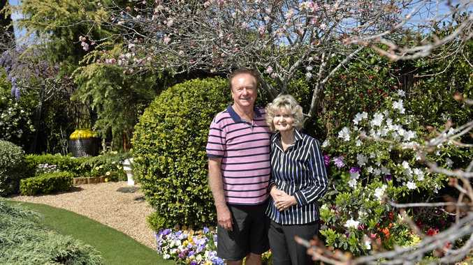 WINNING STREAK: Bob and Val Ford with their Grand Champion garden at 19 Burke St for The Chronicle Garden Competition. INSET: The Burke St yard in full bloom.