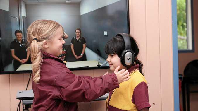 PIONEERS: Chinchilla State School prep students Skyla Staib and Madison Turner-Robinson demonstrate the Health-e-Regions telehealth setup.