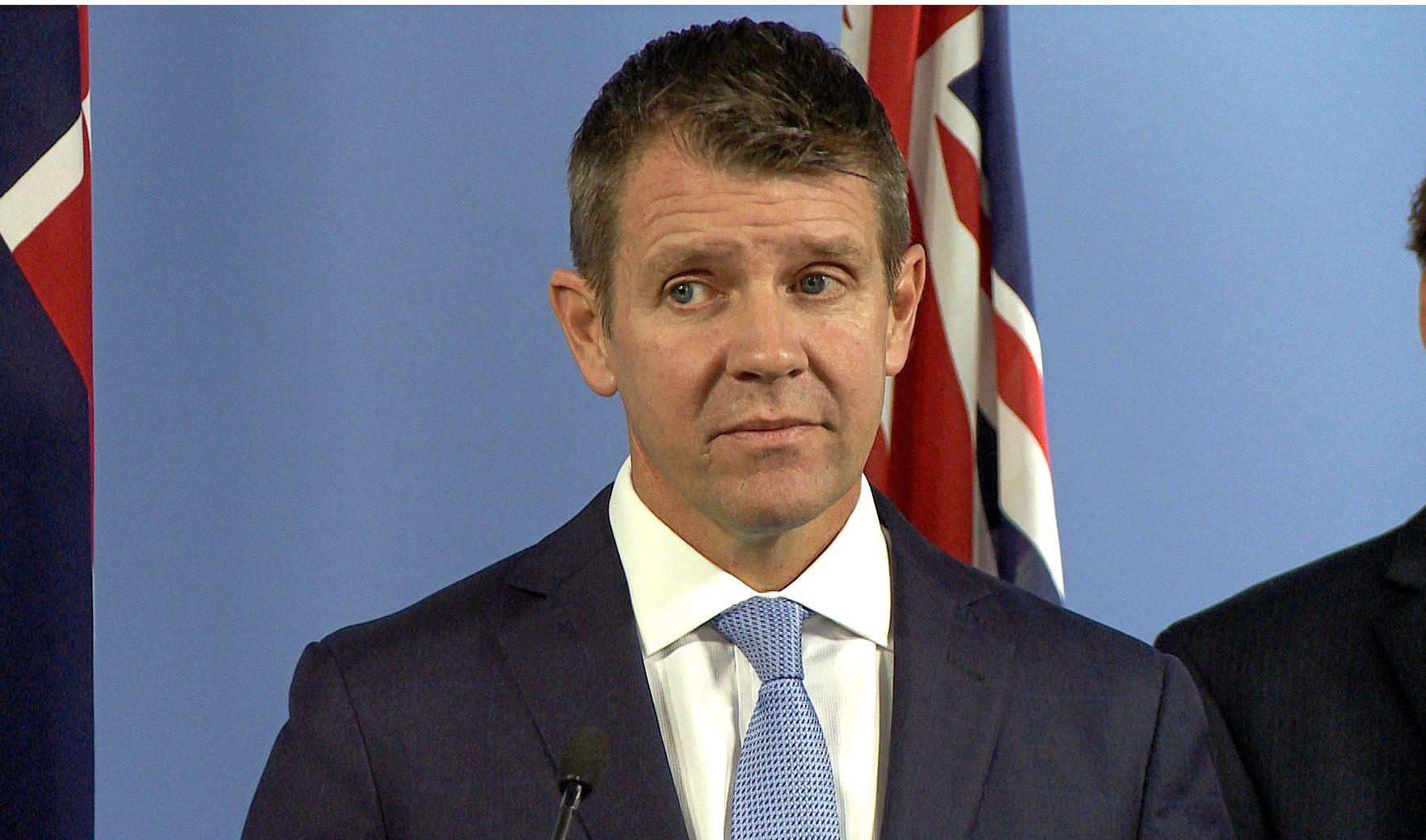 NSW Premier Mike Baird speaks during a press conference in Sydney, Thursday, July 7, 2106.  The NSW government will move legislation to close down the state's greyhound racing industry. The ban would be effective as of 1 July 2017. (AAP Image/Andi Yu) NO ARCHVIING