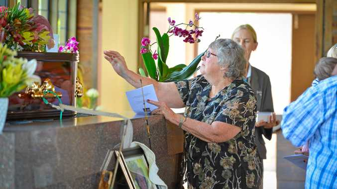 Betty Laver says one final goodbye at the funeral of her husband Trevor Roy Laver yesterday.