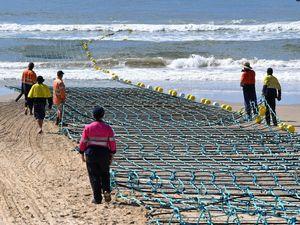 'Volatile' sand spelt shark barrier's demise, says designer