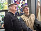 David Keim (left) and Darell Bishop discuss some pieces in the Downlands Art Exhibition Downlands Art Show. September 10, 2016