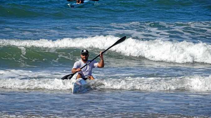 Wade James arrives at Bargara after paddling from Noosa to raise money for The Forget Me Not Fundation. Photo Ben Turnbull