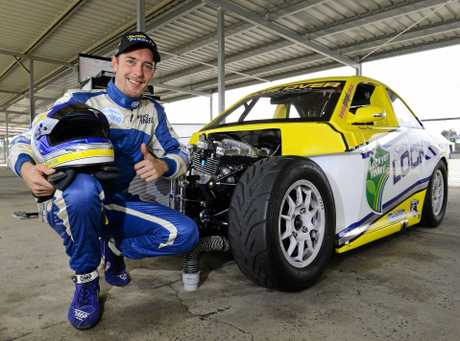 Aussie Racing Car driver Brendon Pingel with his 5/8 scale purpose built racing car that has been rebuilt following a spectacular crash at Queensland Raceway in July.