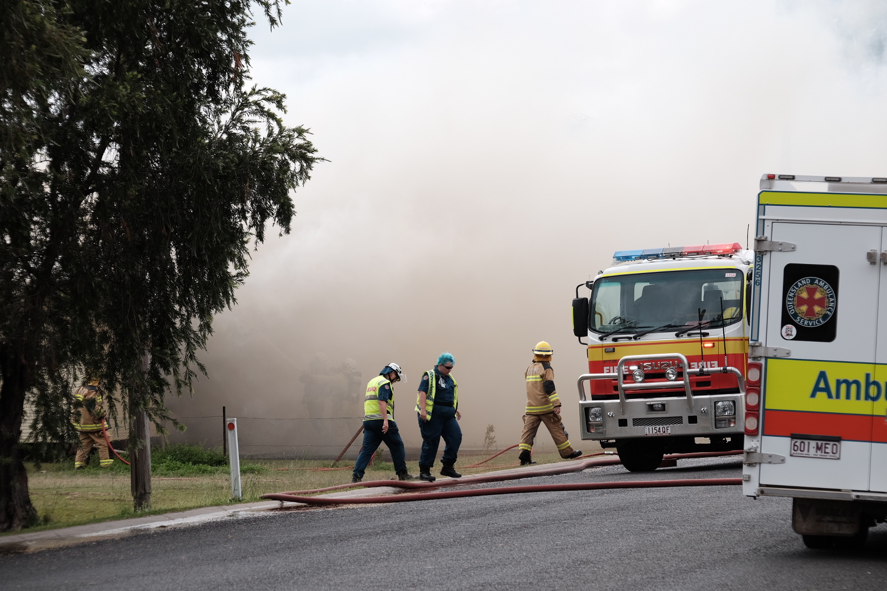 Firefighters battle a destructive house blaze on the western Darling Downs.