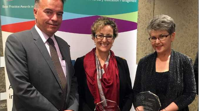 Celebrating a win for USQ in the Association for Tertiary Education Management Awards are (from left) ATEM President and USQ Deputy Vice-Chancellor (Students and Communities) Carl Rallings, Marisa Parker and Fiona Margetts.