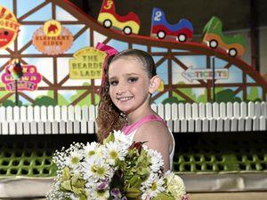 Burns survivor rides high on Carnival of Flowers float