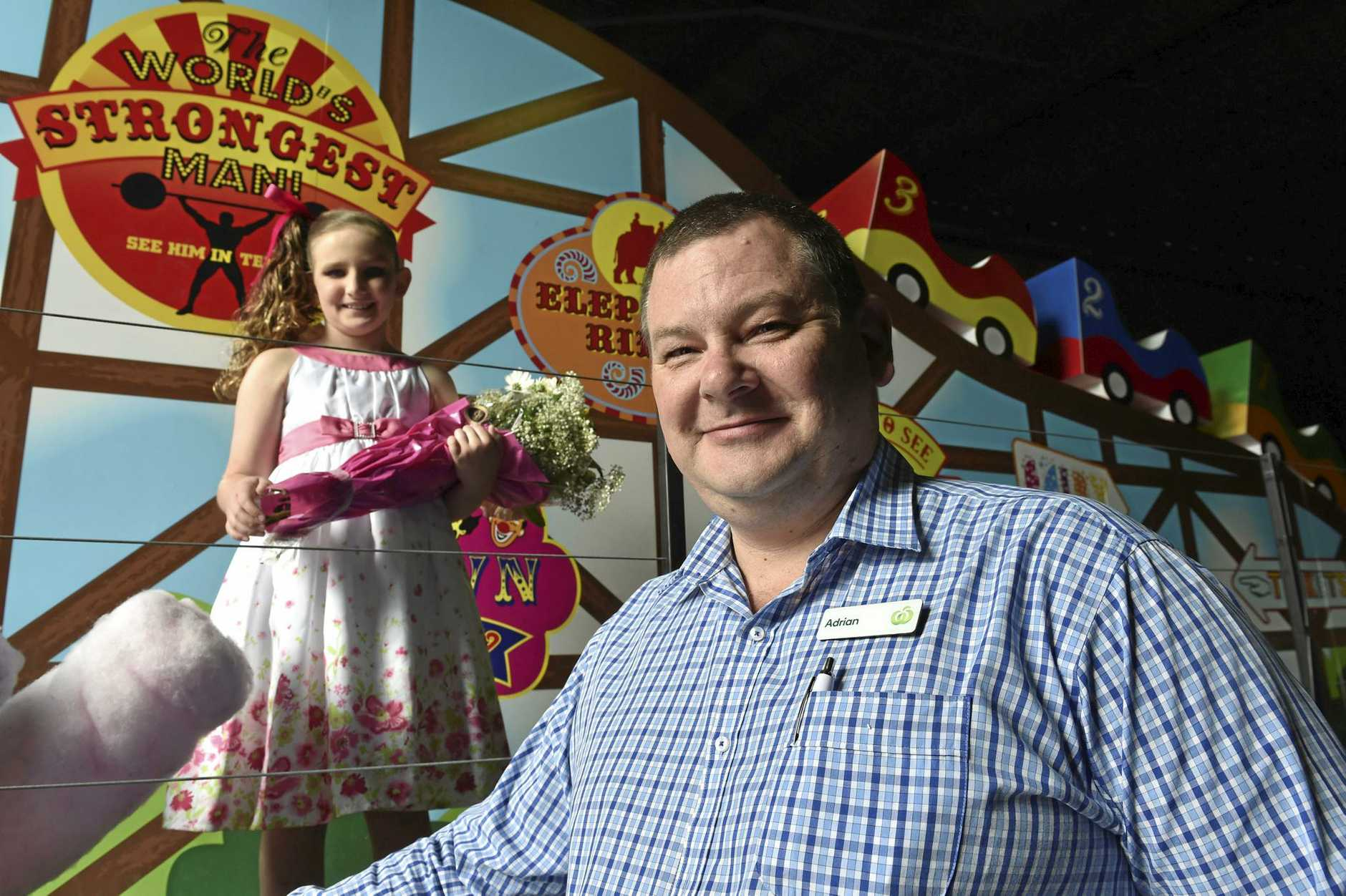 Dalbys Johanna Sinnamon with Range Woolworths store manager Adrian Maynard. Johanna is the Childrens Hospital ambassador and will ride on the circus themed float in the Grand Central Floral Parade. Carnival of Flowers 2016.