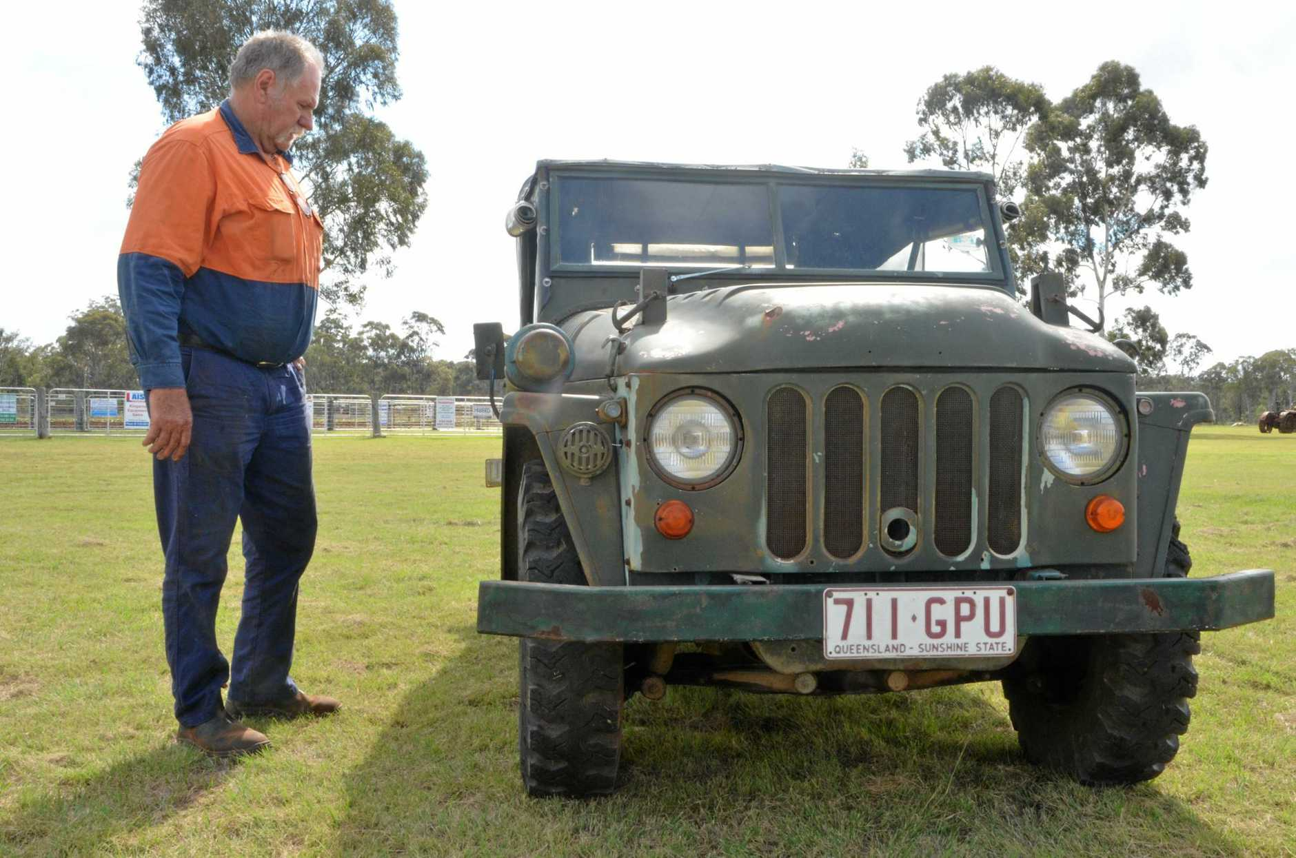 KINGAROY VINTAGE MACHINERY RALLY: Machinery club vice president Matt Londsdale stands next to an old Austin Champ.