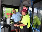 GET ON BOARD: Bus driver Barry Forden signs on with TWU delegate Terry Russell to fight the threats to bus drivers.