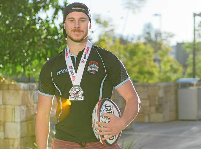 GREAT EXPERIENCE: Josh Hill wears one of the medals he won in rugby while studying at the University of Wisconsin-Whitewater.
