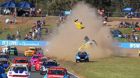 SPECTACULAR SMASH: Gatton driver Brendon Pingel flies through the air in a crash at the Aussie Racing Cars round at Queensland Raceway.